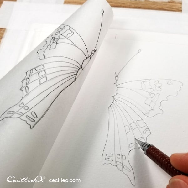 Transfer the drawing with tracing paper.