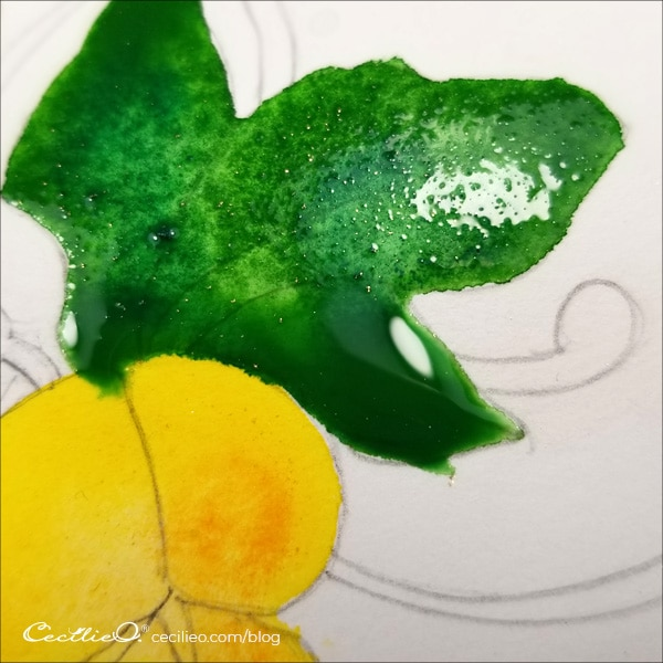Painting the leaves green with abundant  water.