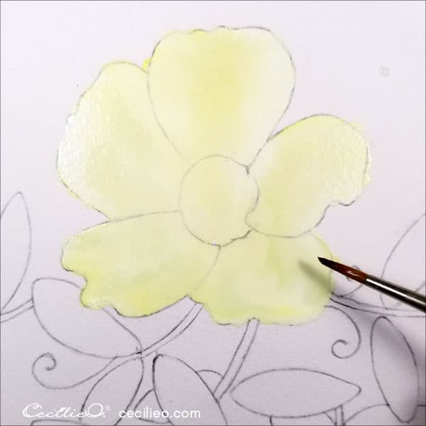 Painting petals with pastel yellow