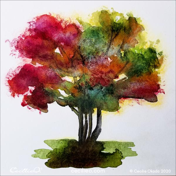 The completed watercolor of a tree in fall colors.