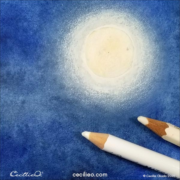 Drawing white light around the moon with white colored pencils.