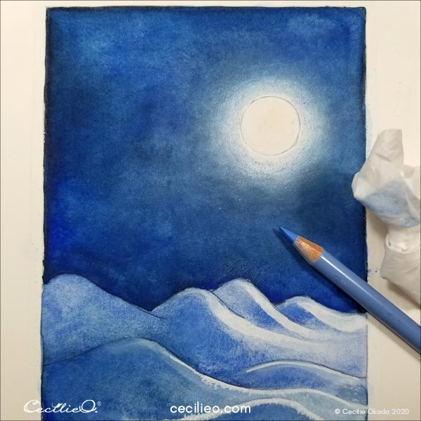 Dimming the light around the moon with colored pencil.