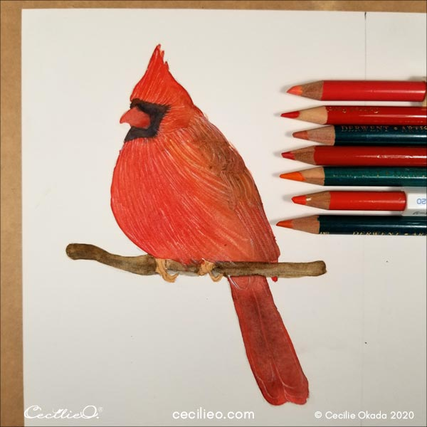 Drawing with multiple red and orange colored pencils.