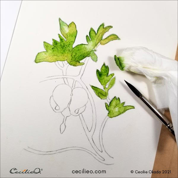 Painting the leaves with watercolor.