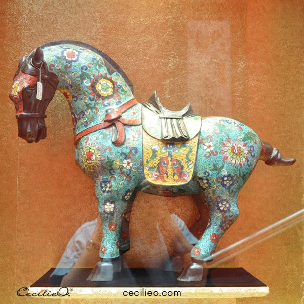 Chinese horse figurine with colorful pattern design.