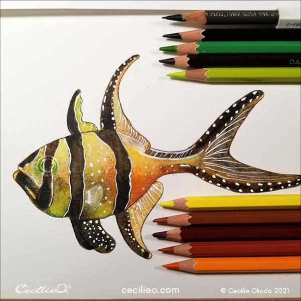 Drawing details with colored pencils.