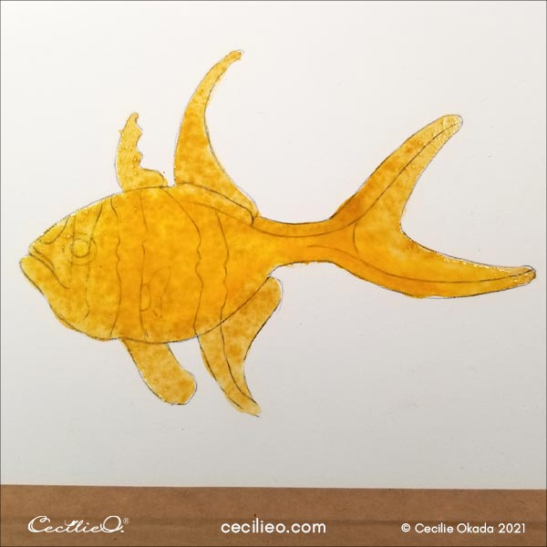 Fish painted with watercolor yellow and ochre.