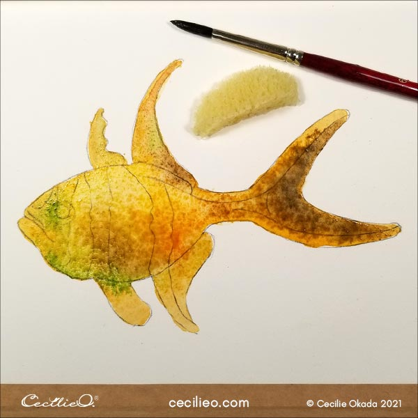 Adding more colors to the fish.