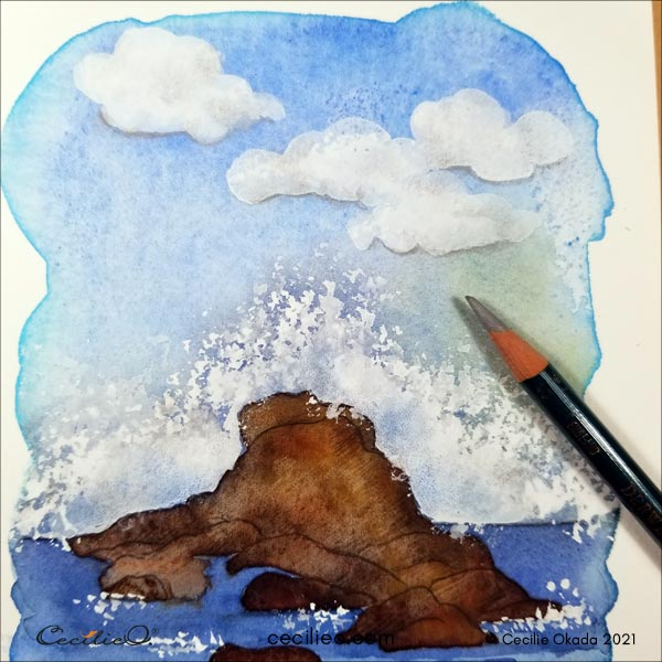 Drawing shadows under the clouds with a grey colored pencil.