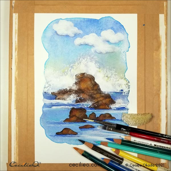 With a variety of colored pencils, as well as more than one brush for the white gouache, entering the creative process.