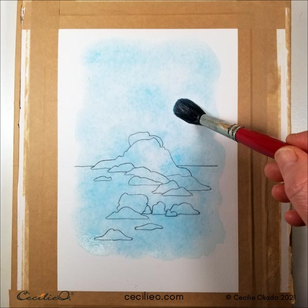 Painting the first watercolor wash in turquoise.