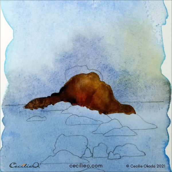 Painting the first rock with various brown watercolors.
